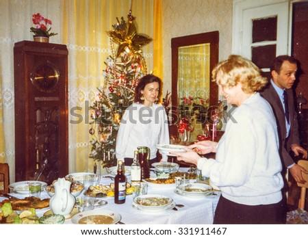 LODZ, POLAND, CIRCA 1990: Vintage photo of family during a Christmas party - stock photo