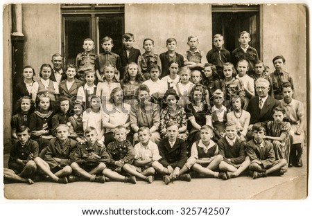 LODZ, POLAND, CIRCA 1940:  Vintage photo of group of school pupils and their tutors - stock photo