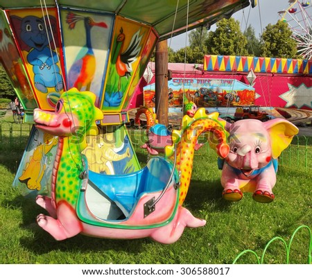 "LODZ,POLAND - JULY 6,2014:Children's carousel - ""Funfair"" in Lodz - stock photo"