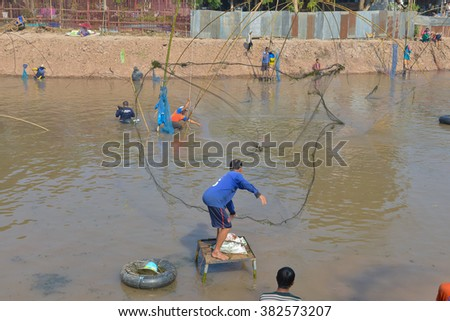 loei , Thailand - FEB 14, 2016: Fishermen are cast a net  in the reservoir. - stock photo