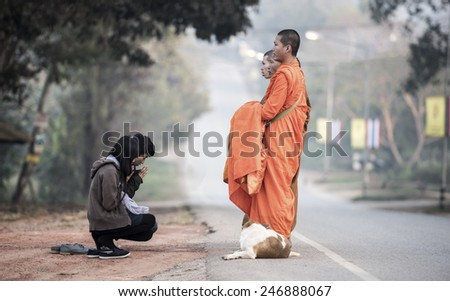 LOEI, THAILAND - JANUARY 17 : People give food offerings to Buddhist monks on January 17, 2015 in Loei, Thailand. - stock photo
