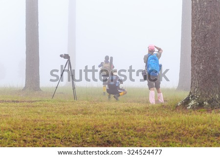 LOEI, THAILAND - Oct 2 : Traveller and Photographer are taking photo of the mist on 2 Oct 2015 at Phu Kradueng National Park, Loei, Thailand - stock photo