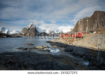 Lofoten mountains and fishing cabins on Hamnoy Island, Norway - stock photo
