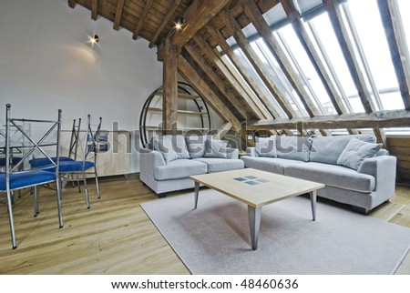 loft apartment of a warehouse conversion with exposed beams - stock photo