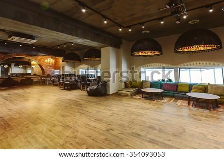 Loft interior design, wooden floor - stock photo