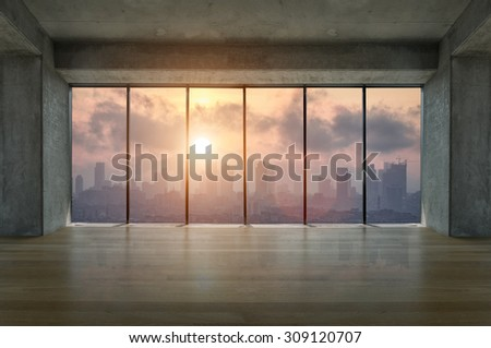 Lofty apartment with wooden floor and large windows during sunrise - stock photo