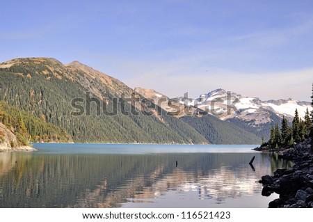 Lofty mountains by a lake - stock photo