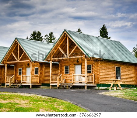 Log cabin by the lake - stock photo