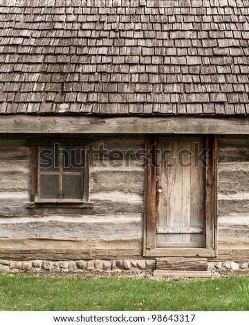 Log cabin door and window - stock photo