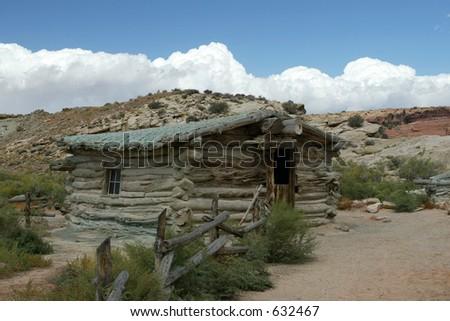 log cabin in desert - stock photo