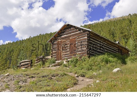 Log cabin in mining town, western USA - stock photo