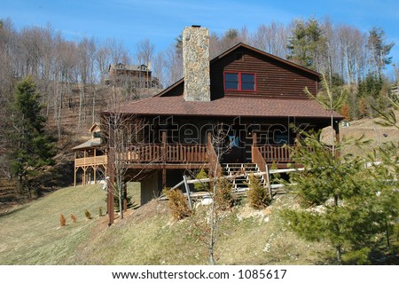 Log cabin in mountains - stock photo