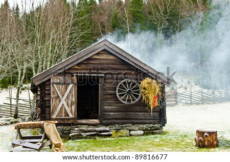 Log cabin in the wood in wintertime - stock photo