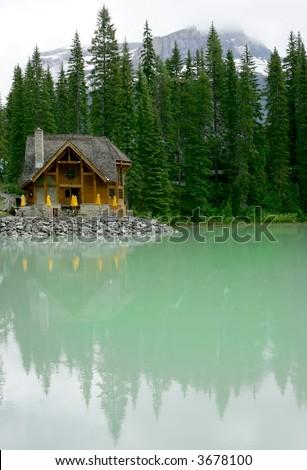 Log cabin lodge on Emerald Lake, Banff National Park, Canada - stock photo