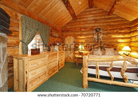 Log Cabin with large furniture and rustic feel. - stock photo