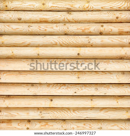 log wall of yellow pine - stock photo