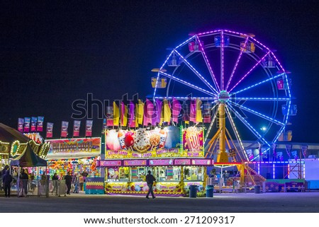 LOGANDALE , NEVADA - APRIL 10 : Amusement park at the Clark County Fair and Rodeo held in Logandale Nevada , USA on April 10 , 2015 - stock photo