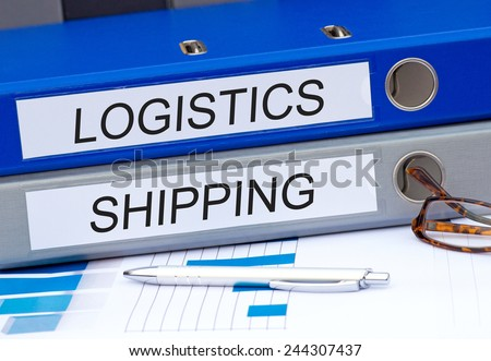 Logistics and Shipping - two binders on desk in the office - stock photo