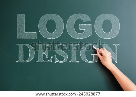 logo written on blackboard - stock photo
