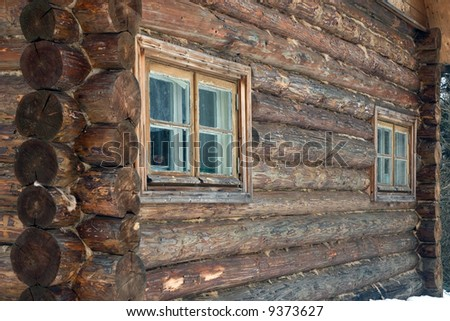 Logs in the wall of old rural house. - stock photo