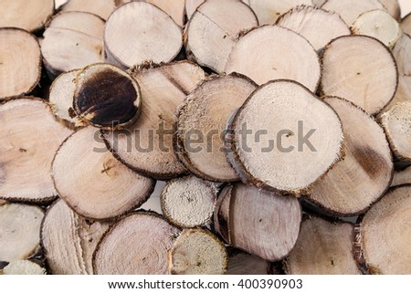 Logs wood cut section texture background, selective focus - stock photo