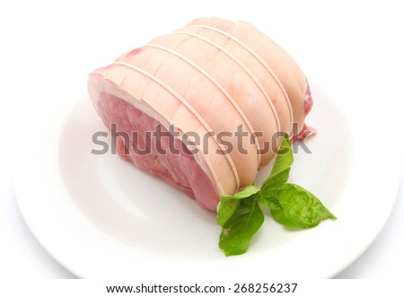 Loin of pork and russed isolated on white - stock photo