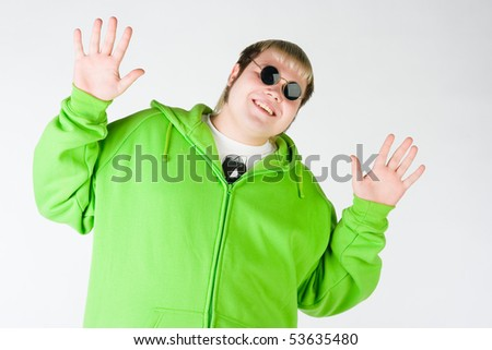 Lol man in a green shirt with black glasses - stock photo