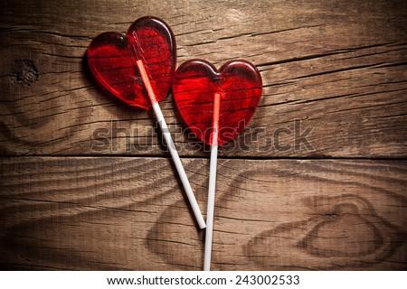 Lollipop heart on vintage wooden background - stock photo