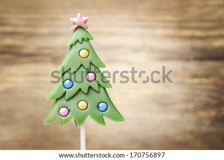 Lollipop in christmas tree shape - stock photo