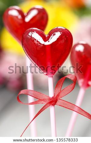 Lollipops in heart shape - stock photo