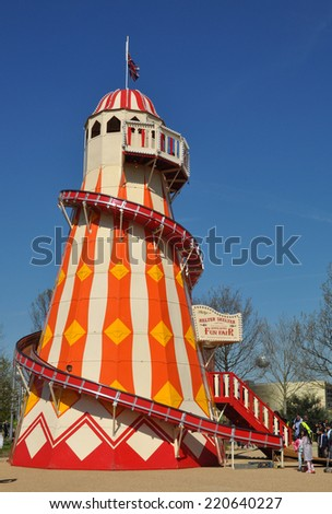 LONDON - APRIL 16. A Helter Skelter on April 16, 2014, at the Queen Elizabeth Olympic Park, a landscaped public area with entertainment, recreation and sports attractions, at Stratford, London. - stock photo