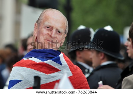 LONDON - APRIL 29: An unidentified man in the crowd wears a 'Duke of Westminster' mask in celebration of the wedding of Prince William and Catherine Middleton on April 29, 2011 in Trafalgar Square, London, England. - stock photo
