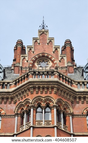LONDON APRIL 10. 2016. Architectural detail of the restored 1868 Victorian Gothic style St Pancras railway station and hotel designed by Sir George Gilbert Scott, located in London, UK - stock photo