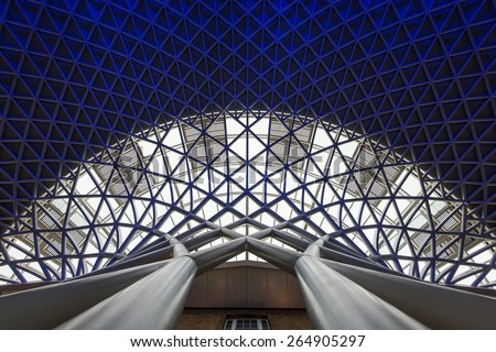 LONDON - APRIL 13, 2013: Architecture detail inside King's Cross railway station. The annual rail passenger usage between 2011 - 2012 was 27.874 million. - stock photo