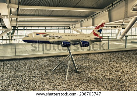 LONDON - APRIL 11, 2014: British Airways airplane in Heathrow airport. British Airways is the flag carrier airline of the United Kingdom, operating 256 aircrafts - stock photo