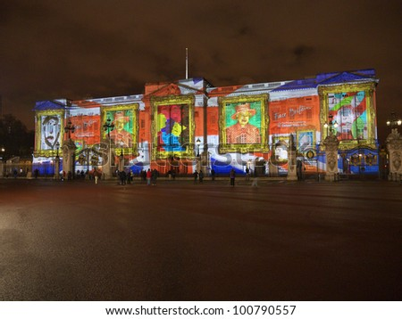 LONDON - APRIL  21: Buckingham Palace projection shows the portrait of Queen Elizabeth and self-portraits of young people in the art project Face Britain on April 21, 2012 in London - stock photo