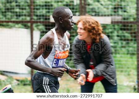 LONDON - APRIL 26: Elite men Emanuel Mutai runs the Virgin Money London Marathon on April 26, 2015 in Isle of Dogs, London, England, UK. - stock photo