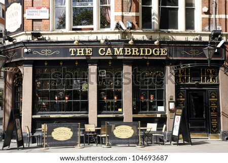 LONDON - APRIL 15: Exterior of pub, for drinking and socializing, focal point of community, on April 15, 2012, London, UK. Pub business, now about 53,500 pubs in the UK, has been declining every year - stock photo