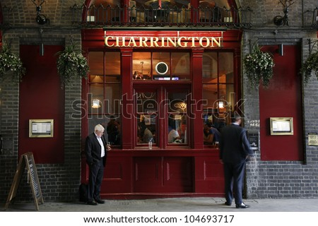 LONDON - APRIL 30: Exterior of pub, for drinking and socializing, focal point of community, on April 30, 2012, London, UK. Pub business, now about 53,500 pubs in the UK, has been declining every year - stock photo