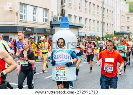 LONDON - APRIL 26: Group of unidentified men run in the Virgin Money London Marathon on April 26, 2015 in Isle of Dogs, London, England, UK. - stock photo