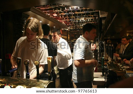 LONDON - APRIL 13:Inside view of pub, for drinking and socializing, focal point of community, on April 13, 2006, London, UK. Pub business, now about 53,500 pubs in UK, has been declining every year - stock photo