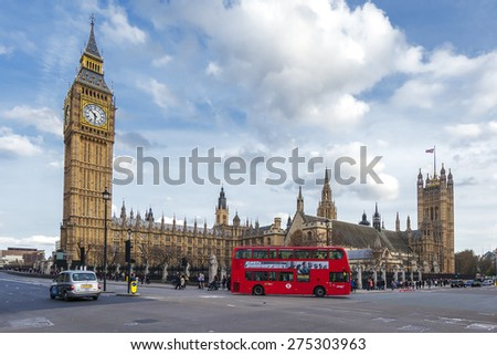 LONDON - APRIL 12: London Bus with Big Ben on April 12, 2015 in London, England. The London Bus service is one of the largest urban bus networks in the world with 8,000 buses covering 700 routes. - stock photo