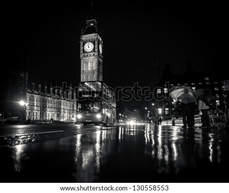 LONDON - April 30: London Buses with Big Ben under the rain on April 30, 2012 in London, England. The London Bus service is one of the largest urban bus networks in the world with 8,000 buses. - stock photo
