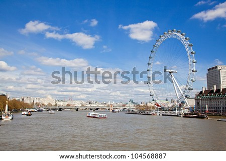 LONDON - APRIL 6: London Eye along River Thames, on April 6, 2012 in London. The largest Ferris wheel in Europe, structure of the London Eye is 135 M. tall and the wheel has a diameter of 120 M. - stock photo