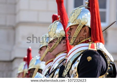 LONDON - APRIL 20: Members of the Household Cavalry on duty at Horse Guards building during the Changing of the Guard in London on April 20, 2012. The Cavalry are the lifeguards of Queen Elizabeth II - stock photo