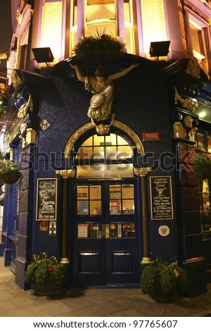 LONDON - APRIL 13: Outside view of pub, for drinking and socializing, focal point of community, on April 13, 2006, London, UK. Pub business, now about 53,500 pubs in UK, has been declining every year - stock photo