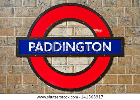 LONDON - APRIL 24: Paddington underground station sign in London, England on April 24, 2013. London's Metropolitan is the oldest underground railway in the world, dating from 1863. - stock photo