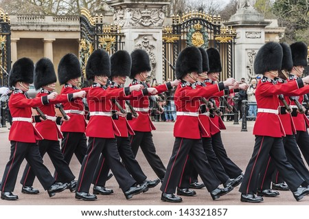 LONDON - APRIL 16: parade of queen's guards outside Buckingham Palace on April 16, 2013 in London - stock photo