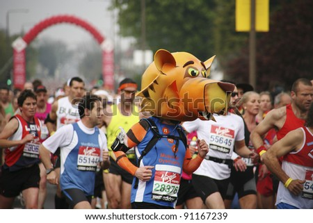 LONDON - APRIL 25: Participant in the London Marathon wearing funny costume on April, 25, 2010 in London, UK. London Marathon is next to New York, Berlin, Chicago and Boston to World Marathon Majors - stock photo