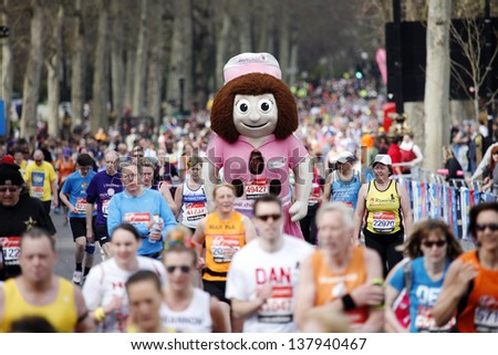 LONDON - APRIL 21: Participant wearing funny costume in the runners of London Marathon on April, 21, 2013 in London, UK. London Marathon is a World Marathon Majors.  - stock photo